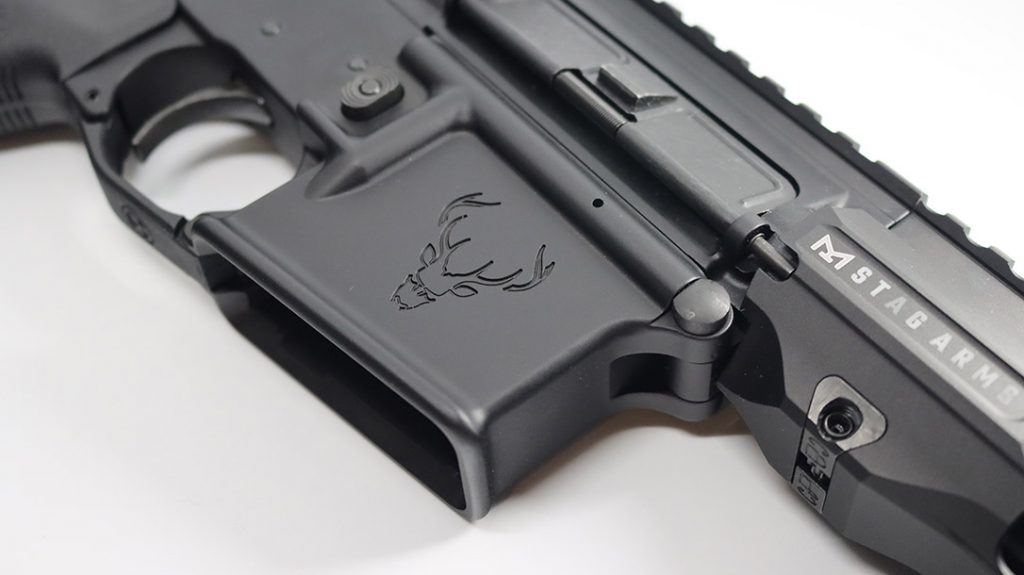 The mag well of the Stag Arms 15 Tactical has the edgier Stag logo embossed in the side.