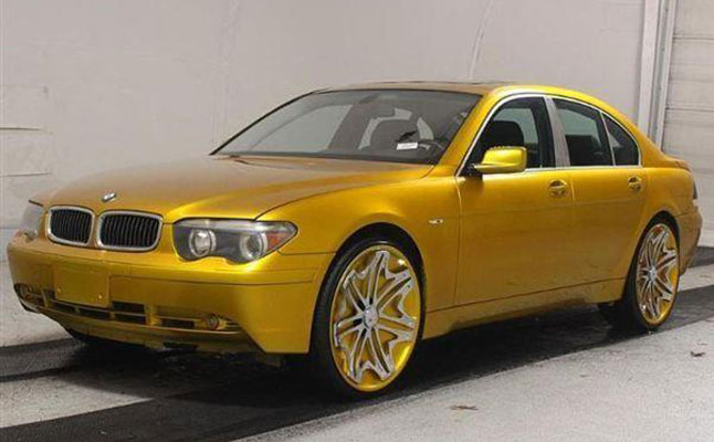 rides cars BMW 7 series gold cotd