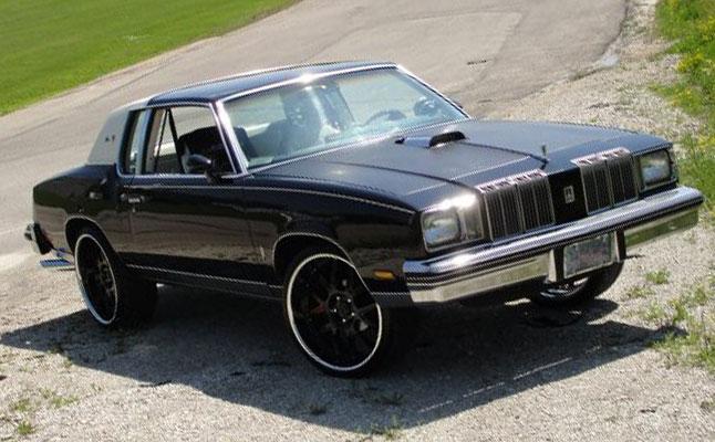 rides cars oldsmobile-cutlass-black-white