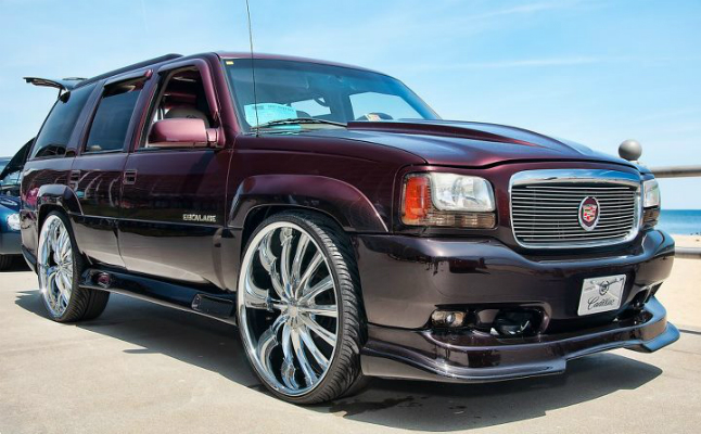 april burke, rides, caddy, cadillac, escalade, interior, jl audio, old school, purple, red, rims, subs