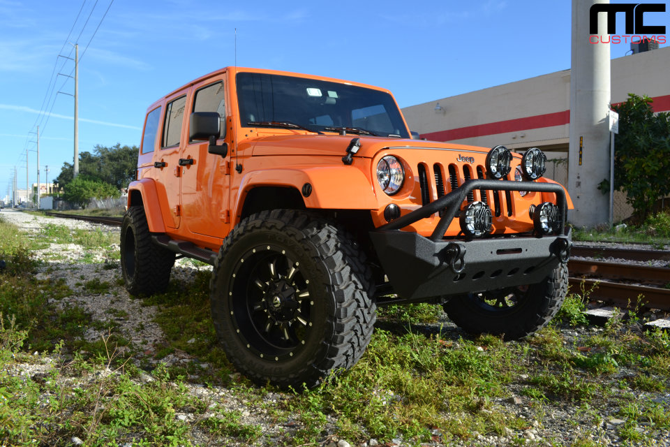 lifted jeep wrangler on fuel wheels and toyo tires by mc