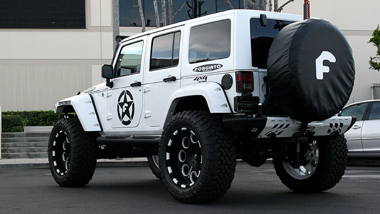 jeep on forgiato offroad wheels with coverking interior