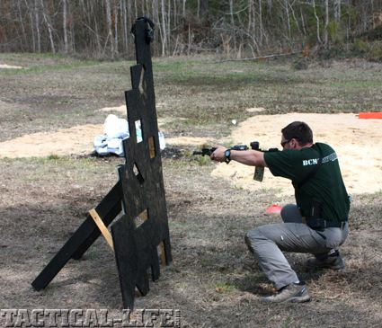 mag-pul-instructor-travis-haley-engages-a-target-through-a-keyhole-in-a-vertical-obstacle4