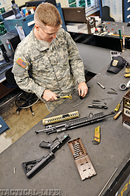 Pfc. Michael Howard of the US Army Marksmanship Unit works on a rear sight post for a M4 in the USAMU Custom Firearms Shop.