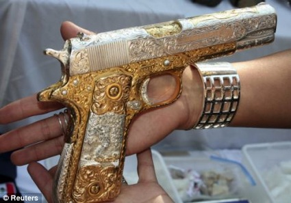 Gold plated AK47 and Colt among haul of gaudy weaponry ...  Real Golden Guns
