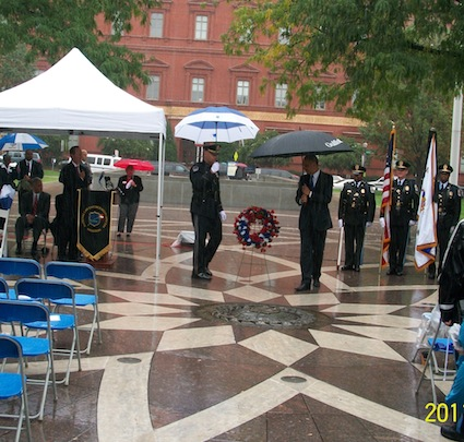 ad-holder-lays-the-wreath-assisted-by-uscp-honor-guard