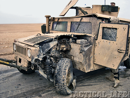 A humvee shows damage from a mine strike