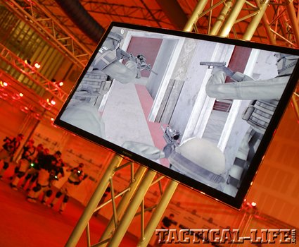 the-virtsim-display-in-a-warehouse-showing-a-team-moving-thorugh-the-situation_phatch