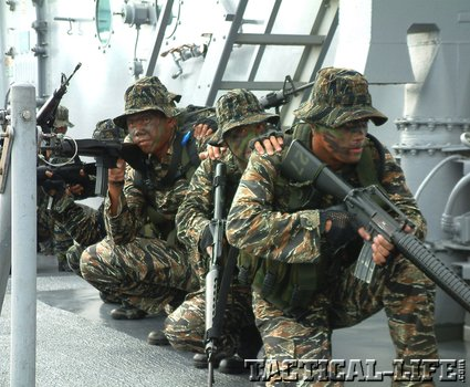 Philippine Naval Special  Warfare operators armed  with M16 rifles train in ship boarding and clearing.