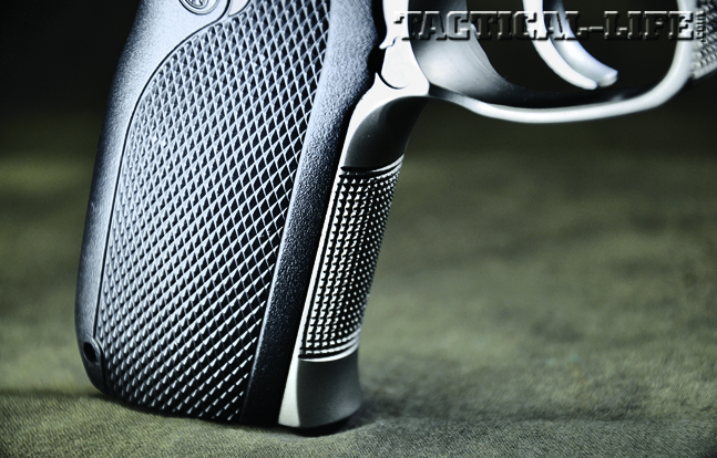 The S&W 1076 features checkering on the grip panels as well as the fronstrap to give FBI agents better control.