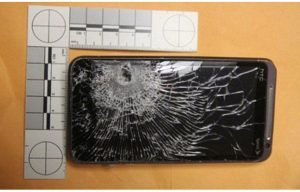 Clerk's Cellphone Stops Bullet