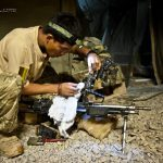 Gurkha cleans his GPMG in Afghanistan - Sept. 2011 (DoD photo)