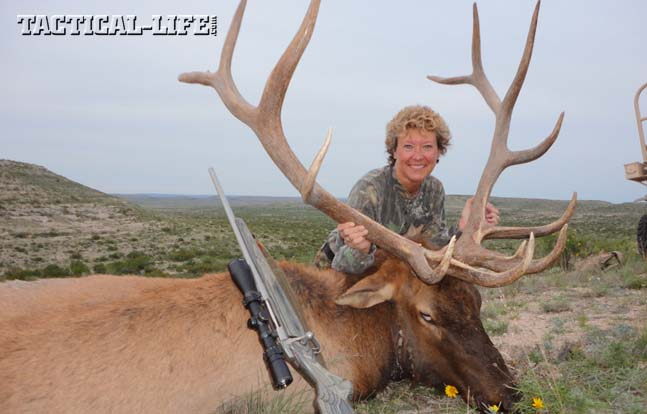 Joyce Wilson with the 6x7 bull she shot soon after arriving at the Longfellow Ranch. The bull took only three steps after she shot it once with her .30-06.