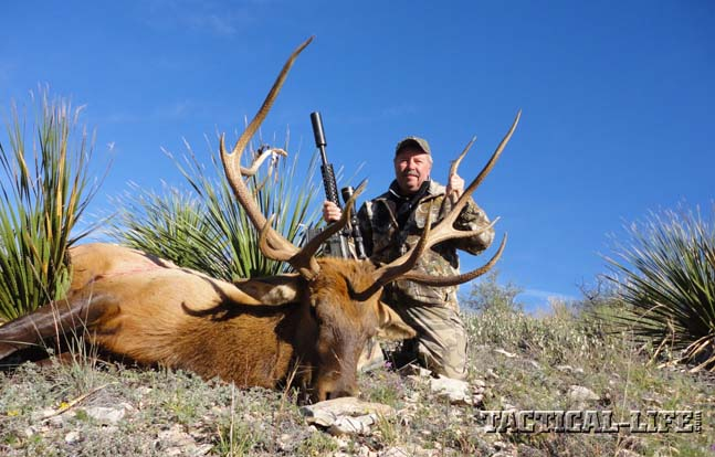 Bill Wilson poses with his 5x6 management bull. He needed all five days of his hunt before locating the bull and dropping it with one shot from his .458 SOCOM.