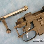 The 527 is similar to the '98 Mauser when it comes to feeding, extraction and ejection. Also note the integral mag well and trigger guard