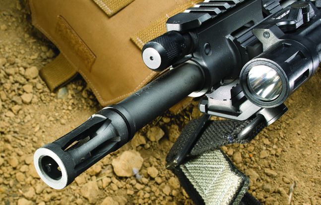 The flash suppressor is cut directly into the barrel to make it a legal 16.12-inch length, even though the rifled portion is only 14.5 inches in length.