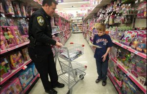 The annual Shop With A Cop program kicked off over the weekend, with over 100 West Virginia children going Christmas shopping with a police officer.