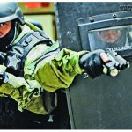 Fauquier County Sheriff's Office SERT members practice tactical movement in a building's tight confines. Because of the county's makeup, SERT must handle both urban and rural scenarios.