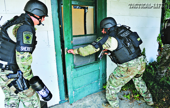 Roughly 90 percent of the SERT's calls are for high-risk warrant service. Here the team perfects its breaching tactics in a mock rural area.