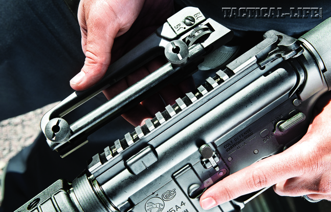 Removing the AR-15A4's carry handle/rear sight reveals a Picatinny rail on top of the upper receiver for mounting optics and accessories.