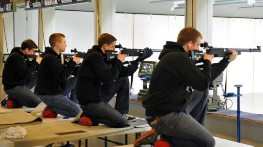 "FORT BENNING, Ga. -- Members of the St. Thomas Academy, Minn. rifle team compete Feb. 26 at the 2013 U.S. Army National Junior Air Rifle Championships. Hosted by the U.S. Army Marksmanship Unit at Pool Indoor Range Complex, site of numerous World Cups, Olympic Trials and National Championships, the match brought state and individual champions to the 'Home of Champions."" St. Thomas took first place overall in the sporter class division. (Photo by Michael Molinaro, USAMU)"