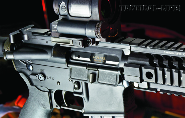 The upper receiver features standard AR components, including a top Picatinny rail, shell deflector, forward assist and charging handle.