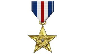 Two US soldiers have received the Silver Star for successfully defending a base in Afghanistan.