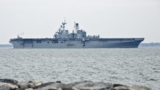 The multipurpose amphibious assault ship USS Bataan (LHD 5) departs Naval Station Norfolk. The Bataan Amphibious Ready Group is departing on a regularly scheduled deployment in support of maritime security operations, crisis response, theater security cooperation and to provide a forward naval presence in the U.S. Navy's 5th and 6th Fleet areas of operation. (U.S. Navy photo by Mass Communication Specialist 1st Class Julie Matyascik/Released)