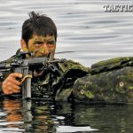 A Canadian soldier conducts a combat surface swim with his Colt Canada C8 carbine during a Patrol Pathfinder course held in Halifax, Nova Scotia.