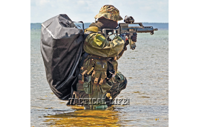 A German Navy Kampfschwimmer scans for targets with his HK G36K carbine, a modular weapon made largely of a carbon-fiber-reinforced polymer.
