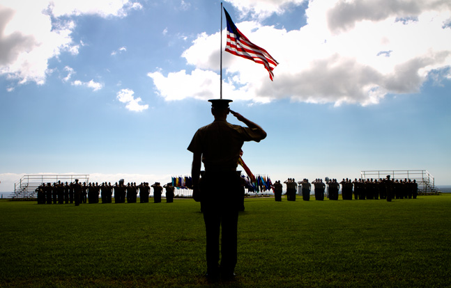 U.S. Marine Corps Lt. Gen. Duane D. Thiessen, the commander of U.S. Marine Corps Forces, Pacific, salutes during the national anthem at a change of office ceremony for Command Master Chief Petty Officers Christopher Aldis and Christopher Angstead at Camp H.M. Smith, Hawaii, January 20, 2012.