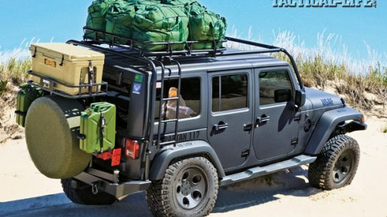 A 2012 four-door Jeep Wrangler JK Sahara with a 3.6-liter Pentastar V6 engine, tricked-out for tactical operations, hits the beach fully loaded and prepared for the worst.