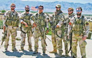 Lt. Murphy (far right) stands with his SEAL team in Afghanistan. They upheld the SEAL tradition of bravery, courage and sacrifice.