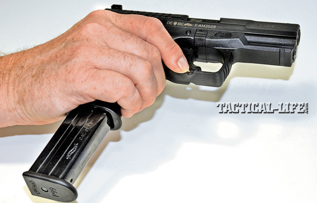 The ambidextrous magazine release runs along the bottom of the triggerguard. Users can learn to activate it quickly with their trigger fingers.
