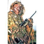 A ROK Marine sniper in a ghillie suit and armed with the Steyr SSG69 sniping rifle.