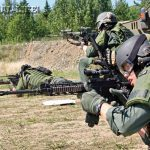 "The Alaska State Trooper SERT ""Summer School"" provides a chance for the entire team to practice, compete and realistically train together on fundamentals such as performing dynamic entries, gas deployment and tactical firearms skills."