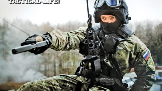A member of an MVD OMOH unit rappels into position to engage wit his pistol. The pistol is a Glock, as Russian special units can purchase weapons from abroad.