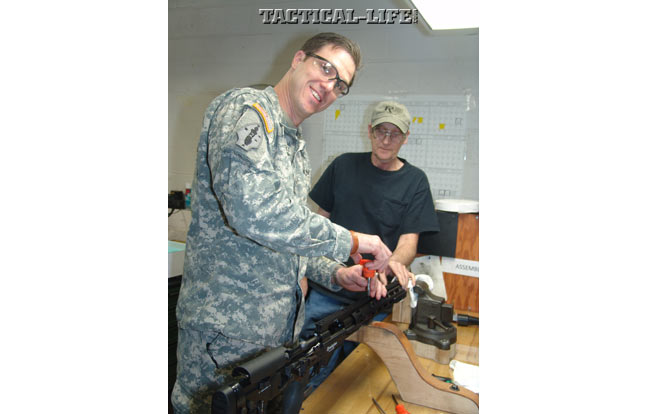 A soldier with the U.S. Army places one of the last screws to secure the monolithic rail on the very last M2010.
