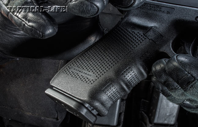 The pistol's grip frame features texturing and finger grooves for enhanced control. Its polymer construction also helps absorb recoil.