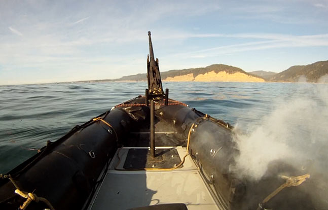 In tests off the California coast, the Lockheed Martin ADAM laser system burns through the hull of a military-grade boat. (Photo credit: Lockheed Martin)