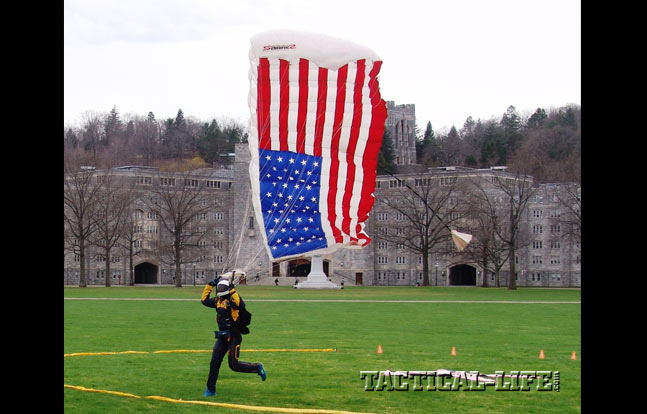 U.S. Military Academy and the U.S. Naval Academy cadets try to hit the center of the landing zone during an inter-service parachute competition at West Point.