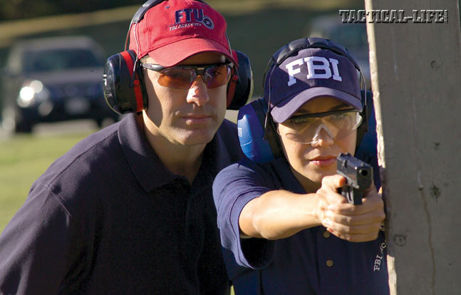 At the FBI Academy is Quantico, Virginia, agents and cadets are taught how to master their .40 caliber Glock pistols from several shooting positions, including from behind cover. Glocks are easy to use and maintain, and have a stellar reputation for reliability.