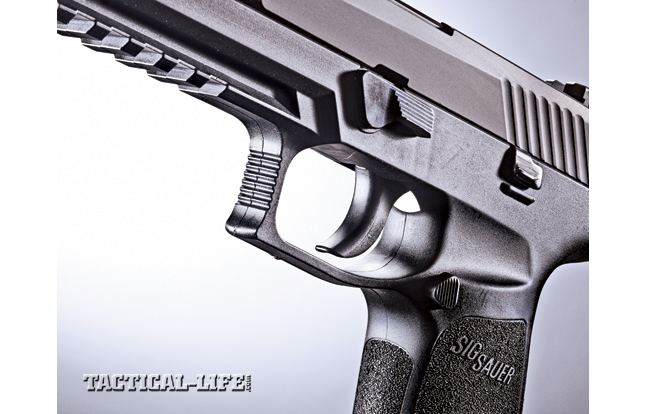 The P320 is available with a smooth-faced trigger (shown) or one with a trigger safety toggle. Either way, it will pass a drop test.