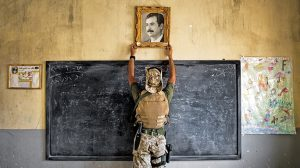 Saddam Hussein's portrait was removed from a classroom by U.S. Forces.