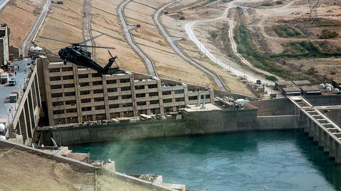 A helicopter oversees the Haditha Dam, which provides electricity to a third of Iraq.
