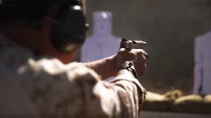The 1st Marine Division works on pistol transitioning drills