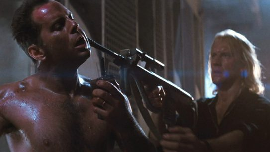 Karl points his Steyr AUG at John McClane in Die Hard
