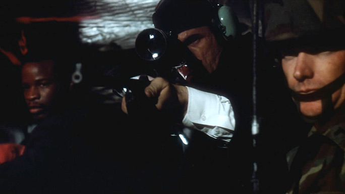 FBI Special Agent Johnson shoots his sniper rifle in Die Hard
