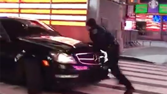 nypd officer fleeing car times square
