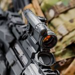 Aimpoint CompM5 sight attached to rifle rail